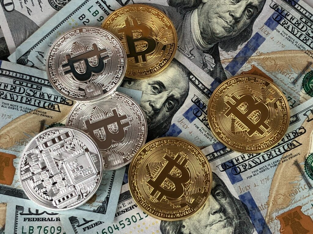 picture of dollar notes and gold coins